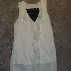 A white and black dressy tank.